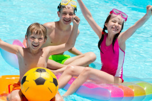 kids-playing-in-backyard-pool